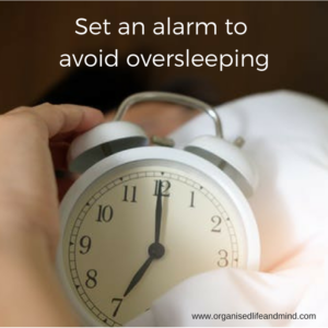 Set an alarm to avoid oversleeping and jetlag